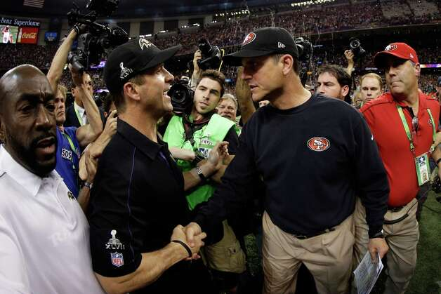Head coach John Harbaugh of the Baltimore Ravens shakes hands with his brother head coach Jim Harbaugh of the San Francisco 49ers after winning Super Bowl XLVII at the Mercedes-Benz Superdome on February 3, 2013 in New Orleans, Louisiana. The Ravens defeated the 49ers 34-31.  (Photo by Ezra Shaw/Getty Images) ***BESTPIX*** Photo: Ezra Shaw, Getty Images / 2013 Getty Images