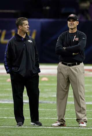 San Francisco 49ers head coach Jim Harbaugh, right, stands with his brother Baltimore Ravens head coach John Harbaugh before the NFL Super Bowl XLVII football game, Sunday, Feb. 3, 2013, in New Orleans. (AP Photo/Bill Haber) Photo: Bill Haber, Associated Press / FR170136 AP