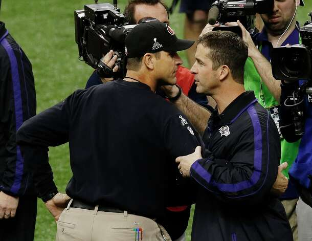 San Francisco 49ers head coach Jim Harbaugh, left, and Baltimore Ravens head coach John Harbaugh meet before the NFL Super Bowl XLVII football game, Sunday, Feb. 3, 2013, in New Orleans. (AP Photo/Gerald Herbert) Photo: Gerald Herbert, Associated Press / AP