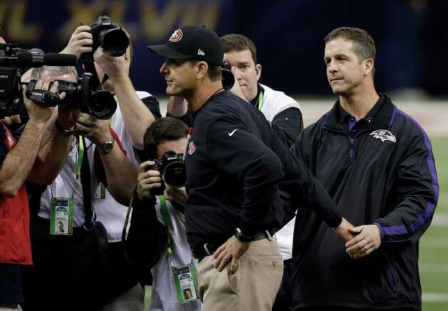 San Francisco 49ers head coach Jim Harbaugh, center, walks away after greeting his brother Baltimore Ravens head coach John Harbaugh before the NFL Super Bowl XLVII football game Sunday, Feb. 3, 2013, in New Orleans. (AP Photo/Bill Haber) Photo: Bill Haber, Associated Press / FR170136 AP