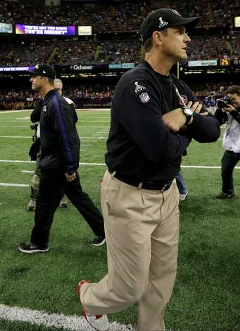 San Francisco 49ers head coach Jim Harbaugh, front, walks past Baltimore Ravens head coach John Harbaugh, rear left, before the NFL Super Bowl XLVII football game, Sunday, Feb. 3, 2013, in New Orleans. (AP Photo/Matt Slocum) Photo: Matt Slocum, Associated Press / AP