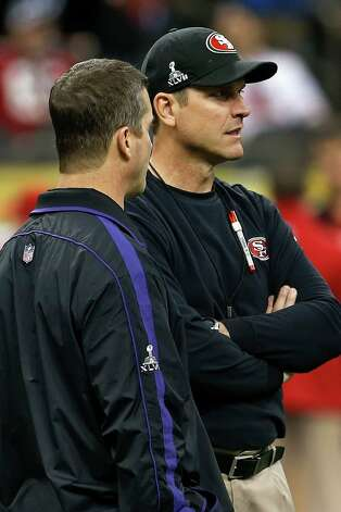 Baltimore Ravens head coach John Harbaugh, left, and San Francisco 49ers head coach Jim Harbaugh talk on the field before the NFL Super Bowl XLVII football game, Sunday, Feb. 3, 2013, in New Orleans. (AP Photo/Julio Cortez) Photo: Julio Cortez, Associated Press / AP