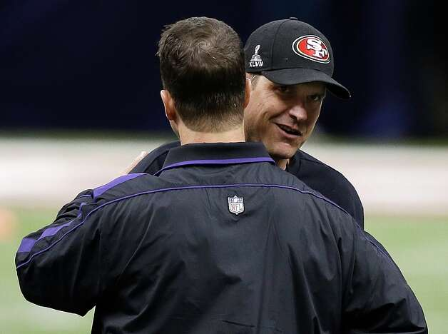 San Francisco 49ers head coach Jim Harbaugh, right, embraces Baltimore Ravens head coach John Harbaugh before the NFL Super Bowl XLVII football game, Sunday, Feb. 3, 2013, in New Orleans. (AP Photo/Bill Haber) Photo: Bill Haber, Associated Press / FR170136 AP