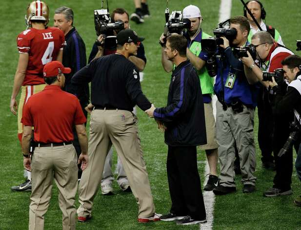 San Francisco 49ers head coach Jim Harbaugh, left, and Baltimore Ravens head coach John Harbaugh meet before the NFL Super Bowl XLVII football game Sunday, Feb. 3, 2013, in New Orleans. (AP Photo/Gerald Herbert) Photo: Gerald Herbert, Associated Press / AP