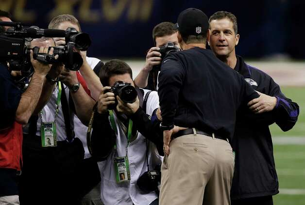 San Francisco 49ers head coach Jim Harbaugh, left, embraces his brother Baltimore Ravens head coach John Harbaugh before the NFL Super Bowl XLVII football game, Sunday, Feb. 3, 2013, in New Orleans. (AP Photo/Bill Haber) Photo: Bill Haber, Associated Press / FR170136 AP