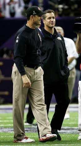 San Francisco 49ers head coach Jim Harbaugh, left, and Baltimore Ravens head coach John Harbaugh chat before the NFL Super Bowl XLVII football game, Sunday, Feb. 3, 2013, in New Orleans.  (AP Photo/Matt Slocum) Photo: Matt Slocum, Associated Press / AP