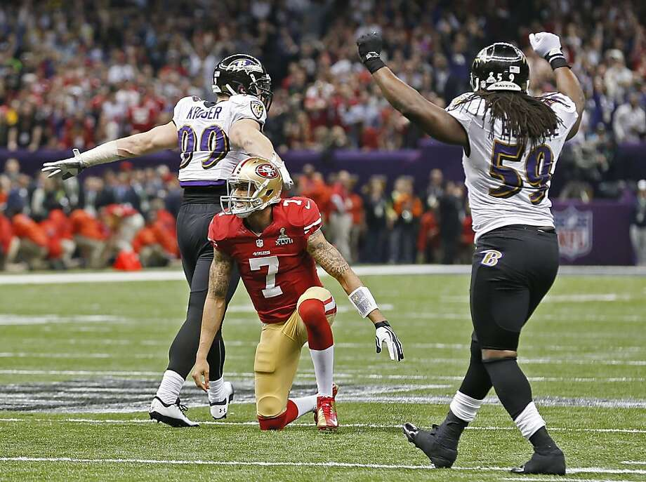 Ravens Paul Kruger and Danell Ellerbe celebrate as the 49ers quarterback Colin Kaepernick watches his pass to teammate Michael Crabtree falls incomplete on their last play of the game for San Francisco, as the San Francisco 49ers fall to the Baltimore Ravens 34-31 in Superbowl XLVII at the Mercedes-Benz Superdome in New Orleans, La. on Sunday Feb. 3, 2013. Photo: Michael Macor, The Chronicle