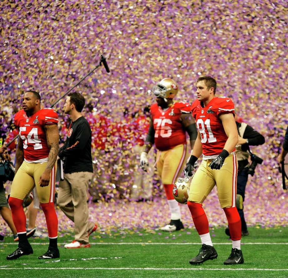 San Francisco 49ers' Larry Grant, left, Ray McDonald, right, and Anthony Davis, rear right, walk off the field after the team's 34-31 loss to the Baltimore Ravens in the NFL Super Bowl XLVII football game Sunday, Feb. 3, 2013, in New Orleans. Photo: Mark Humphrey, Associated Press / AP