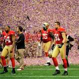 San Francisco 49ers' Larry Grant, left, Ray McDonald, right, and Anthony Davis, rear right, walk off the field after the team's 34-31 loss to the Baltimore Ravens in the NFL Super Bowl XLVII football game Sunday, Feb. 3, 2013, in New Orleans.