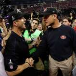 Head coach John Harbaugh of the Baltimore Ravens shakes hands with his brother head coach Jim Harbaugh of the San Francisco 49ers after winning Super Bowl XLVII at the Mercedes-Benz Superdome on February 3, 2013 in New Orleans, Louisiana. The Ravens defeated the 49ers 34-31.