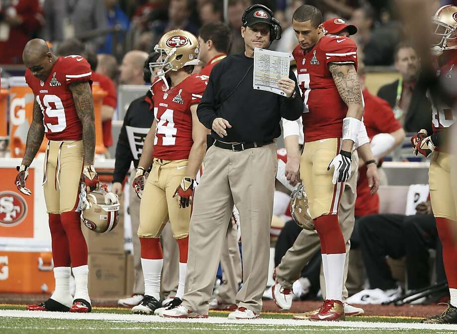 49er head coach Jim Harbaugh and quarterback Colin Kaepernick looks over plays late in the fourth quarter during a time out, as the San Francisco 49ers went on to fall to the Baltimore Ravens 34-31 in Superbowl XLVII at the Mercedes-Benz Superdome in New Orleans, La. on Sunday Feb. 3, 2013. Photo: Michael Macor, The Chronicle