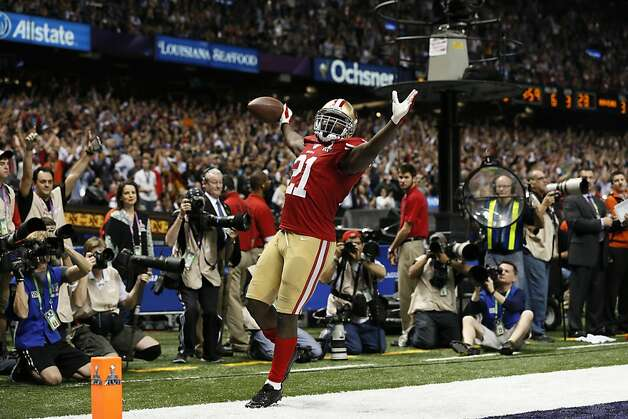 Frank Gore celebrates his third-quarter touchdown that reduced the 49ers' deficit to 28-20. Gore rushed for a 49ers Super Bowl-record 110 yards but didn't carry during their final four scrimmage plays. Photo: Michael Macor, The Chronicle