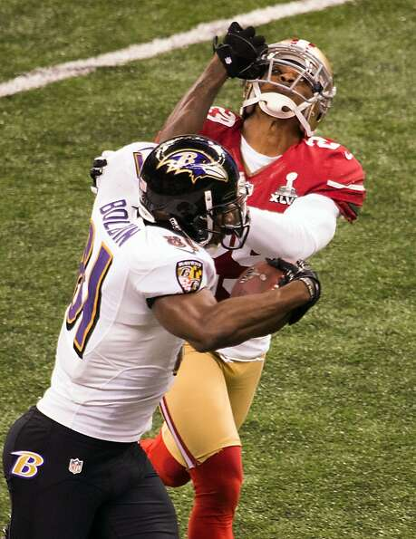 Baltimore Ravens wide receiver Anquan Boldin (81) pushes away San Francisco 49ers defensive back Chr