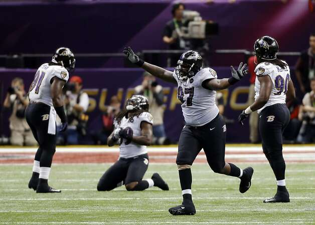The Baltimore Ravens celebrate after the 49ers failed to score on their last possession in the fourth quarter while trailing 34-29, and the Ravens took over on downs. The San Francisco 49ers played the Baltimore Ravens in  Super Bowl XLVII, on Sunday, February 3, 2013, in New Orleans, La. Photo: Carlos Avila Gonzalez, The Chronicle