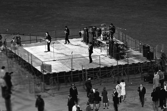 The Beatles perform at Candlestick Park on August 29, 1966.