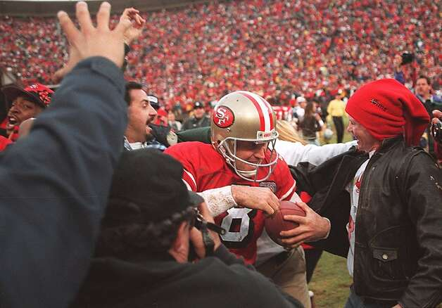 Steve Young is mobbed by fans who ran on the field after the 49ers win the NFC Championship over Dallas on Jan. 15, 1995. Candlestick Park, home of many S.F. memories, will be turned into a shopping development when the 49ers move to Santa Clara. Photo: Deanne Fitzmaurice
