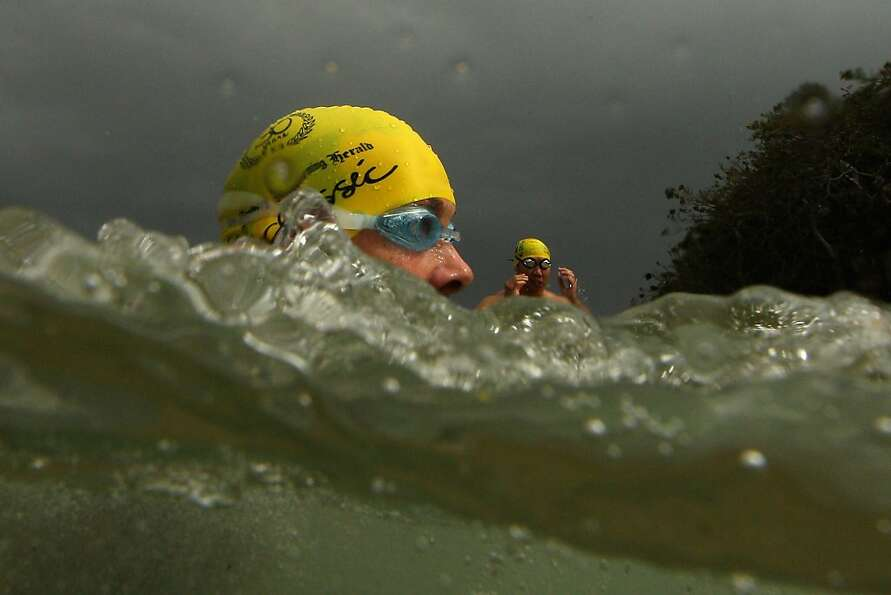 Swimmers race during the 2013 Cole Classic at Shelly Beach on February 3, 2013 in Manly, Australia.