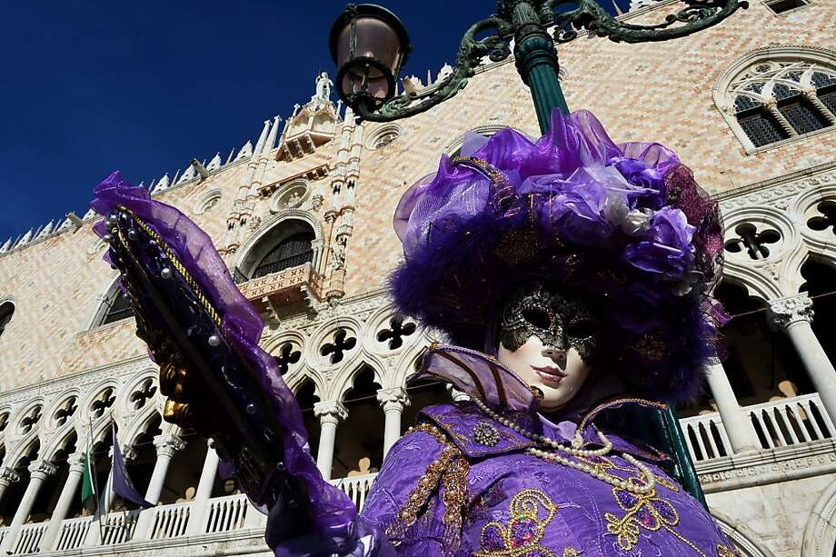 "A costumed reveller poses at St Mark's square during the carnival on February 3, 2013 in Venice. The 2013 edition of the Venice carnival is untitled "" Live in Colour"" and runs from January 26 to February 12. Photo: Vincenzo Pinto, AFP/Getty Images"