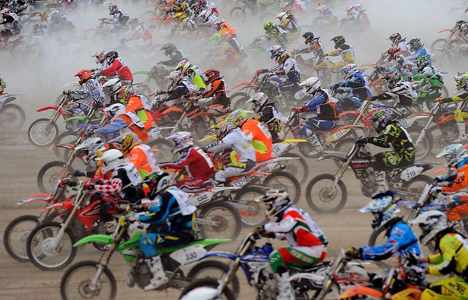Competitors ride on the beach during the 8th edition of the Touquet Enduropal motorcycling race on February 3, 2013 in Le Touquet, northern France. The Touquet Enduropal motorcycling replaces the traditional Enduro, created by Thierry Sabine motorcycle racer - founder and main organizer of Paris Dakar, in the 80s. Some 1,000 competitors attend the 11,800 km race. Photo: Denis Charlet, AFP/Getty Images