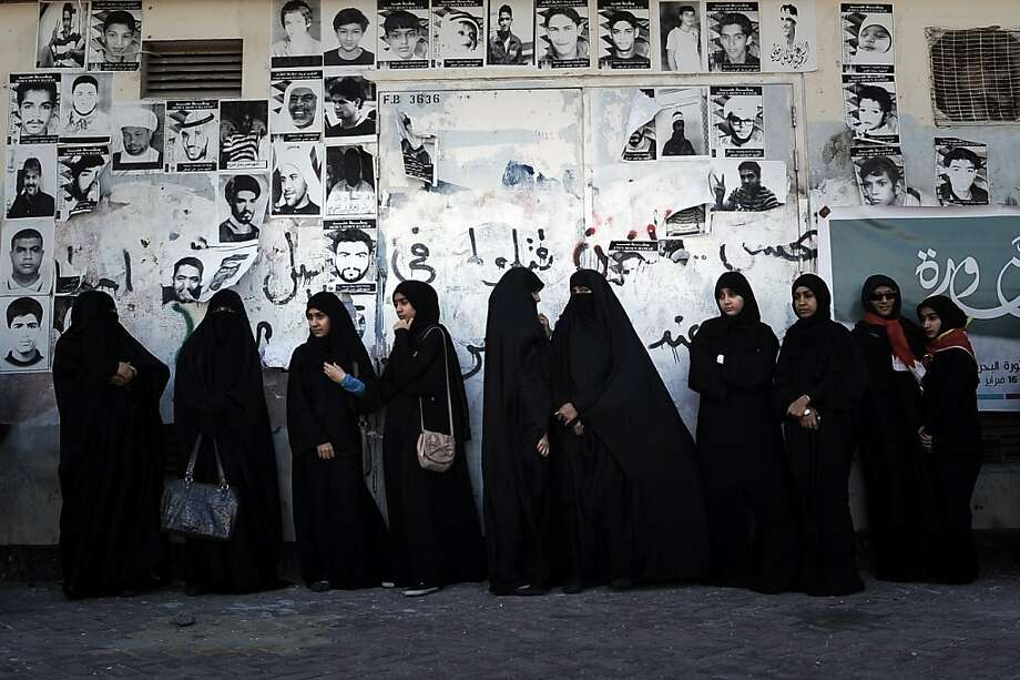 Bahraini Shiite Muslim women, some of whom are wearing the niqab, stand watching an anti-government rally to demand reforms in the village of Malikiyah, South of Manama, on February 3, 2013, . The Gulf state has been shaken by unrest since its forces in March 2011 crushed a month of popular Shiite-led protests demanding greater rights and an end to what they said was discrimination by the Sunni royals. Photo: Mohammed Al-shaikh, AFP/Getty Images