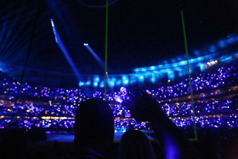 Glowing LED fingers light up the stands during the halftime show for Superbowl XLVII at the Mercedes-Benz Superdome on Sunday February 3, 2013, New Orleans, La. Photo: Mike Kepka, The Chronicle