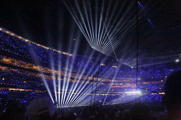 Lasers and glowing LED fingers light up the stands during the halftime show for Superbowl XLVII at the Mercedes-Benz Superdome on Sunday February 3, 2013, New Orleans, La. Photo: Mike Kepka, The Chronicle