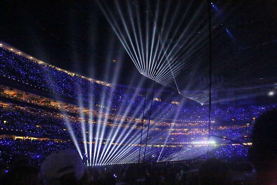 Lasers and glowing LED fingers light up the stands during the halftime show for Superbowl XLVII at t