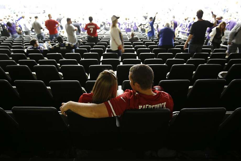 Brian and Amanda Evans of Salinas, Calif., watch as Ravens fans celebrate after the Ravens defeated the 49ers 34-31 in the Super Bowl. The San Francisco 49ers played the Baltimore Ravens in  Super Bowl XLVII, on Sunday, February 3, 2013, in New Orleans, La. Photo: Carlos Avila Gonzalez, The Chronicle
