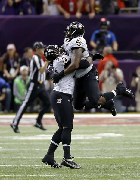 Michael Oher, left, and Arthur Jones, right, celebrate as the Ravens took over on downs after the 49