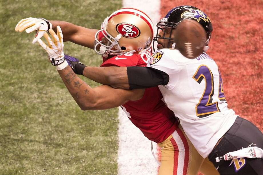 Baltimore Ravens cornerback Corey Graham (24) breaks up a pass intended for San Francisco 49ers wide receiver Michael Crabtree (15) on  a second down attempt during the 49ers final drive fourth quarter of Super Bowl XLVII at the Mercedes-Benz Superdome on Sunday, Feb. 3, 2013, in New Orleans. Photo: Smiley N. Pool, Chronicle