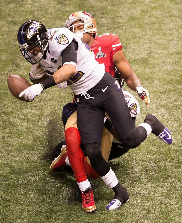 Baltimore Ravens cornerback Jimmy Smith (22) breaks up a pass intended for San Francisco 49ers wide receiver Michael Crabtree (15) on  a third down attempt during the 49ers final drive fourth quarter of Super Bowl XLVII at the Mercedes-Benz Superdome on Sunday, Feb. 3, 2013, in New Orleans. Photo: Smiley N. Pool, Chronicle