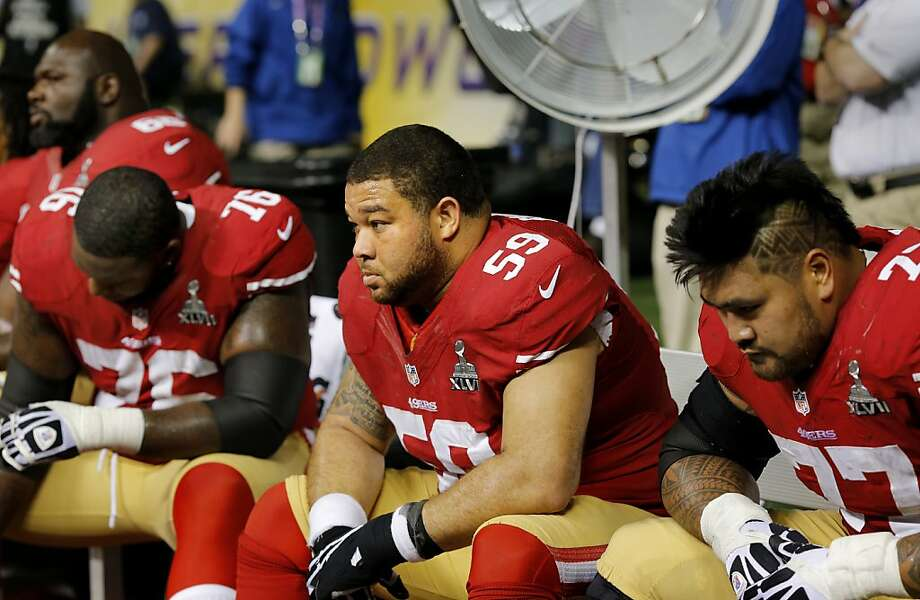 During the lights out stage of the game, with the 49ers down by two touchdowns, Mike Iupati (right), center Jonathan Goodwin and Anthony Davis (76) sat on the bench. The Baltimore Ravens defeated the San Francisco 49ers in Super Bowl XLVVII 34-31 Sunday February 3, 2013. Photo: Brant Ward, The Chronicle