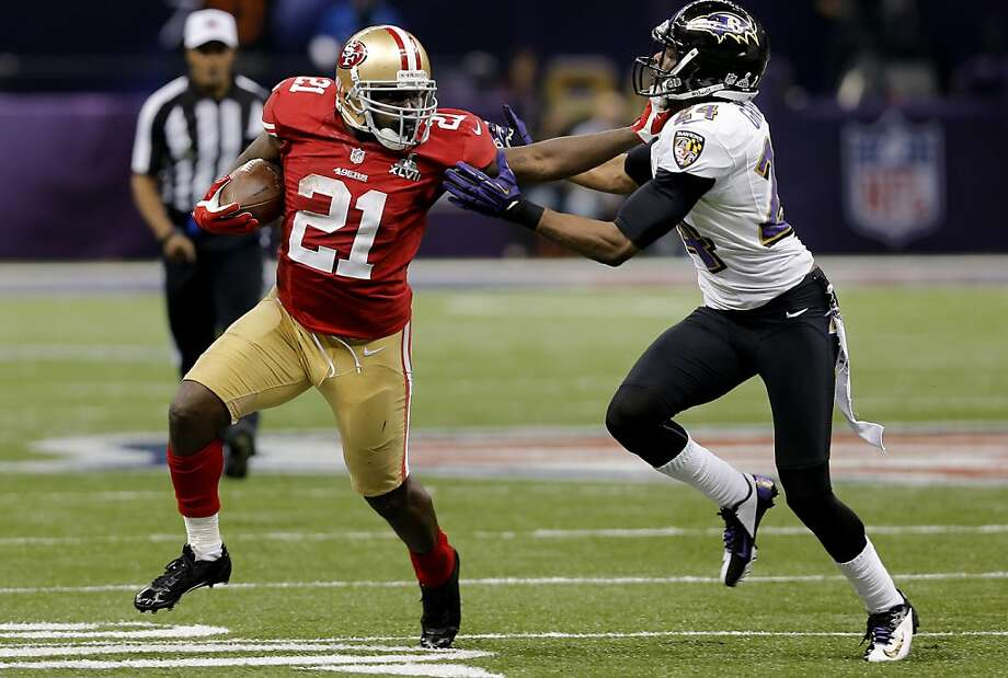 Frank Gore fought with defender Corey Graham in the fourth quarter. The Baltimore Ravens defeated the San Francisco 49ers in Super Bowl XLVVII 34-31 Sunday February 3, 2013. Photo: Brant Ward, The Chronicle