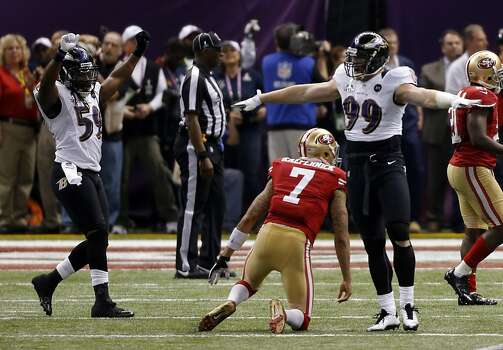 Baltimore Ravens Dannell Ellerbe, left, and Paul Kruger, celebrate as Colin Kaepernick gets up after failing to complete a pass to Michael Crabtree in the 49ers' last possession while they trailed 34-29. The San Francisco 49ers played the Baltimore Ravens in  Super Bowl XLVII, on Sunday, February 3, 2013, in New Orleans, La. Photo: Carlos Avila Gonzalez, The Chronicle