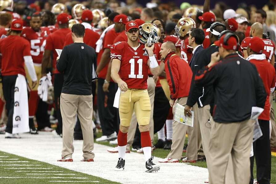 Quarterback Alex Smith (11) on the sidelines during the first half of Superbowl XLVII between the Sa