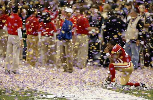 Perrish Cox watches from the sideline as the Ravens celebrate after winning the Super Bowl after defeating the 49ers 34-31. The San Francisco 49ers played the Baltimore Ravens in  Super Bowl XLVII, on Sunday, February 3, 2013, in New Orleans, La. Photo: Carlos Avila Gonzalez, The Chronicle