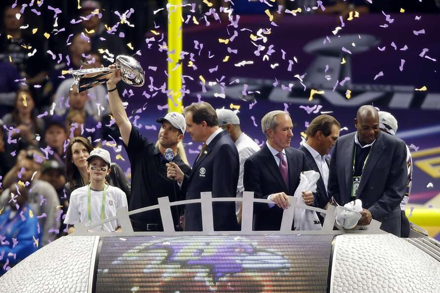 John Harbaugh, head coach of the Baltimore Ravens, holds the Lombardi Trophy after the Ravens defeat