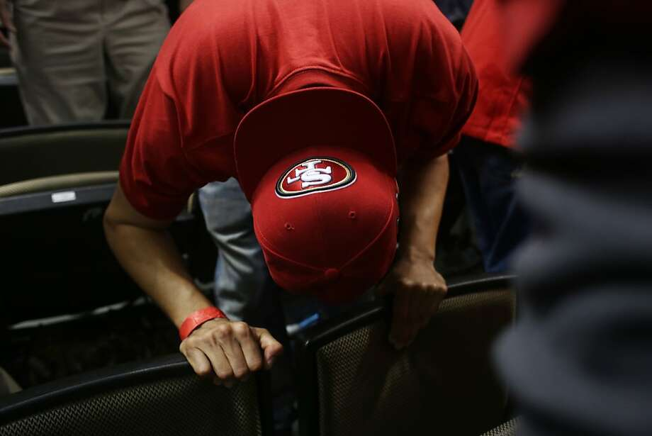 Juan Trujillo, of San Francisco, puts his head down during the final minutes of the game just before the Baltimore Ravens beat the San Francisco 49ers in Superbowl XLVII at the Mercedes-Benz Superdome on Sunday February 3, 2013, New Orleans, La. Photo: Mike Kepka, The Chronicle