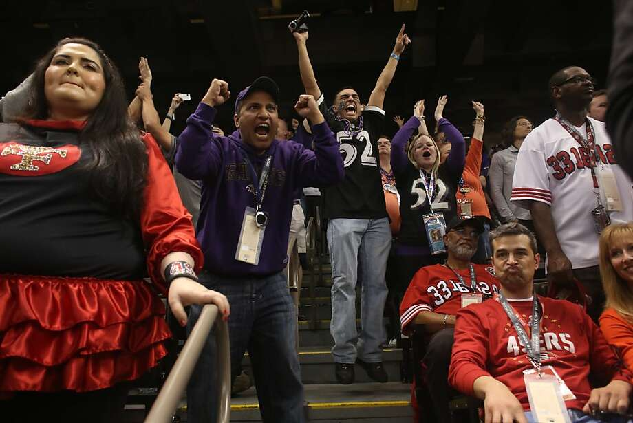 Ravens fans cheers as Tamara Solari (lft) and Robbie McGovern (Rt) look on after the Baltimore Ravens beat the San Francisco 49ers in Superbowl XLVII at the Mercedes-Benz Superdome on Sunday February 3, 2013, New Orleans, La. Photo: Mike Kepka, The Chronicle