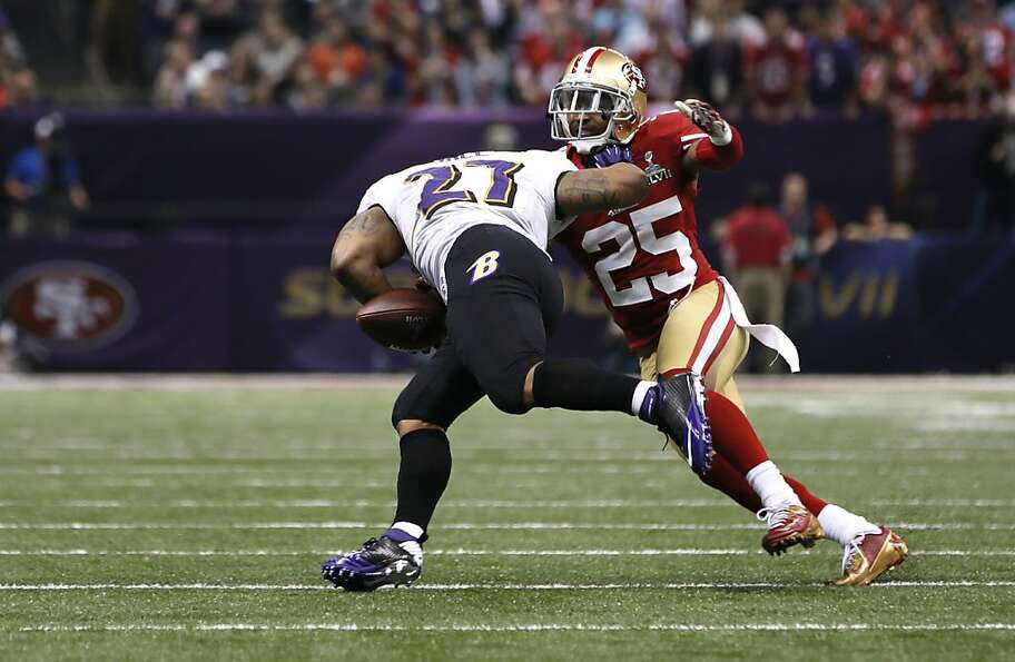 Cornerback Tarell Brown (25) forces a fumble on running back Ray Rice (27) during the second half of