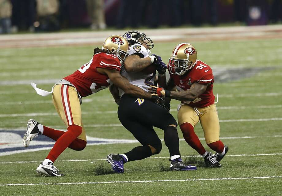 running back Ray Rice (27) is tackled during the second half of Superbowl XLVII between the San Francisco 49ers and the Baltimore Ravens at the Mercedes-Benz Superdome on Sunday February 3, 2013 in New Orleans, La. Photo: Carlos Avila Gonzalez, The Chronicle