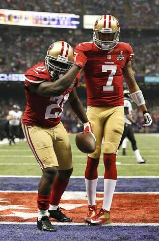 San Francisco 49ers Running back Frank Gore (21) keapernicks while celebrating with Quarterback Colin Kaepernick (7) after running in a touchdown in the third quarter of Superbowl XLVII between the San Francisco 49ers and the Baltimore Ravens at the Mercedes-Benz Superdome on Sunday February 3, 2013 in New Orleans, La. Photo: Michael Macor, The Chronicle