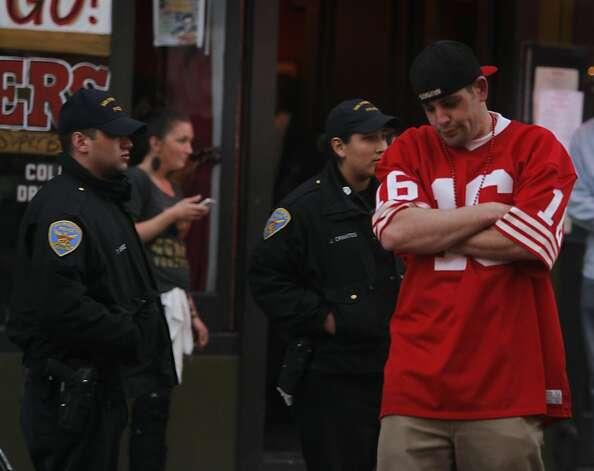 Niners fan Robert Bullard looks less than pleased after the Baltimore Ravens returned a kickoff for a touchhdown to open the second half, while he watches the Super Bowl outside a North Beach club, in San Francisco, Calif. on Sunday, Feb. 3, 2013. Photo: Paul Chinn, The Chronicle