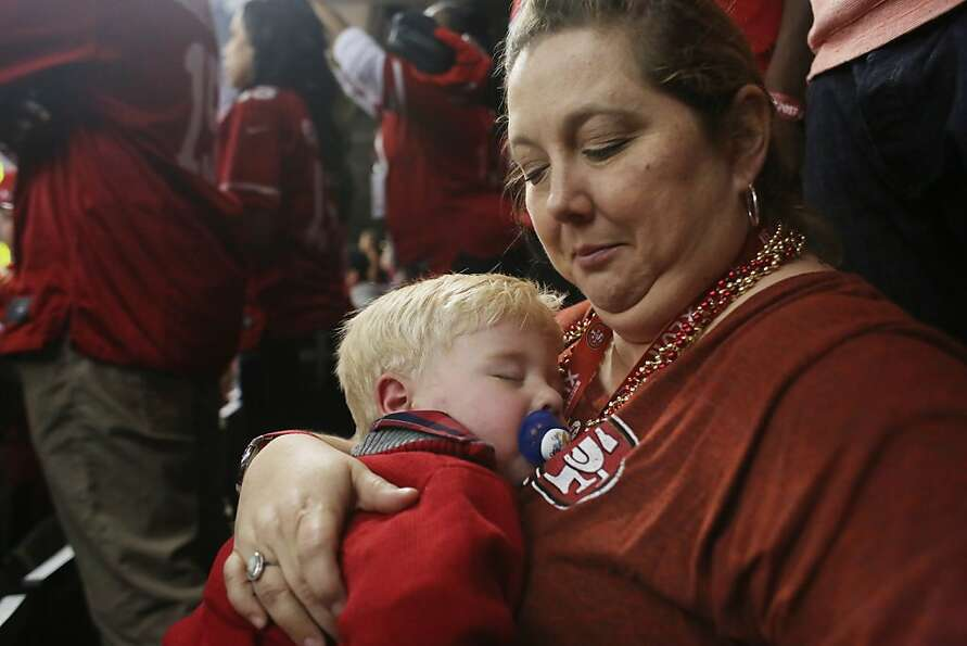 Nanny Shelly Buller holds sleeping Hudson Smith, 20 months, son of Niners Alex Smith during first qu