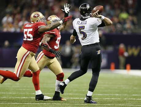 Baltimore Ravens quarterback Joe Flacco (5)  throughs through an attempted block in the first half of Superbowl XLVII between the San Francisco 49ers and the Baltimore Ravens at the Mercedes-Benz Superdome on Sunday February 3, 2013 in New Orleans, La. Photo: Michael Macor, The Chronicle