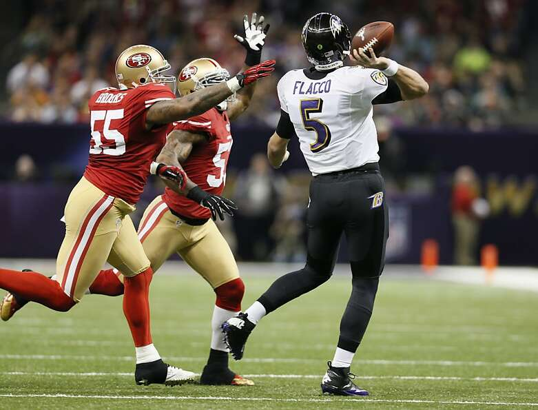 Baltimore Ravens quarterback Joe Flacco (5)  throughs through an attempted block in the first half o