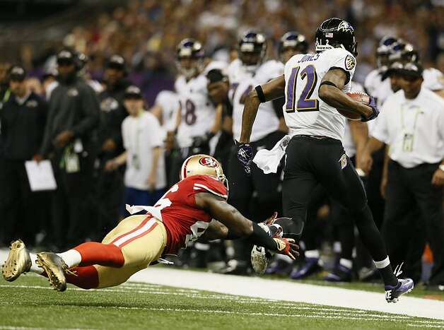 Baltimore Ravens wide receiver Jacoby Jones (12) catches a long pass through the attempted tackle of tight end Delanie Walker (46) in the first half of Superbowl XLVII between the San Francisco 49ers and the Baltimore Ravens at the Mercedes-Benz Superdome on Sunday February 3, 2013 in New Orleans, La. Photo: Michael Macor, The Chronicle