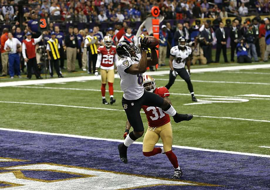 Baltimore Ravens wide receiver Anquan Boldin (81) catches a touchdown over the head of Safety Donte Whitner (31) in the first quarter of Superbowl XLVII between the San Francisco 49ers and the Baltimore Ravens at the Mercedes-Benz Superdome on Sunday February 3, 2013 in New Orleans, La. Photo: Carlos Avila Gonzalez, The Chronicle