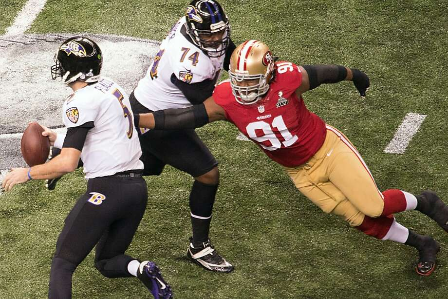 Baltimore Ravens quarterback Joe Flacco (5) scrambles away from San Francisco 49ers defensive end Ray McDonald (91) during the first quarter of Super Bowl XLVII at the Mercedes-Benz Superdome on Sunday, Feb. 3, 2013, in New Orleans. Photo: Smiley N. Pool, Chronicle
