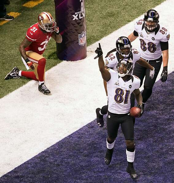 Baltimore Ravens wide receiver Anquan Boldin (81) celebrates after scoring on a 13-yard touchdown pa